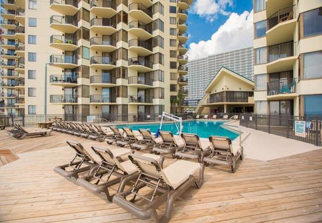 Located Next To The World Famous Restaurant Pinele S Sunbird Iniums In Panama City Beach Offer A Lively Tropical Resort Atmosphere